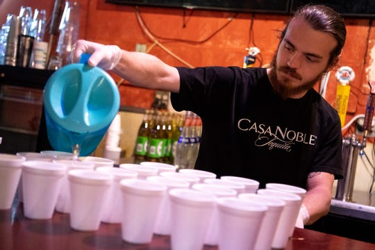 Sam Lowry prepares margaritas at Rosepepper Cantina in Nashville, Tenn., Wednesday, April 1, 2020. The East Nashville restaurant has adapted to the times by creating an efficient method for fulfilling take-out food and margarita orders.