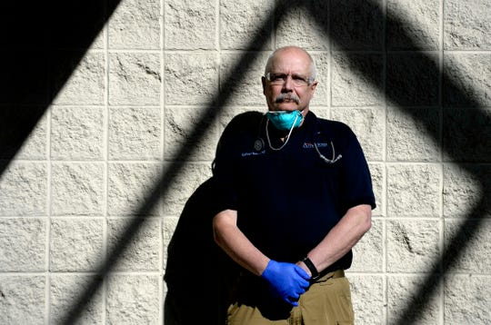 """Cookeville Regional Medical Center Dr. Sullivan """"Sully"""" Smith,  a 32-year veteran of the hospital's emergency room, is photographed on Thursday, April 2, 2020, in Cookeville, Tenn. Smith has been on the frontlines with other staff members taking care of COVID-19 patients."""