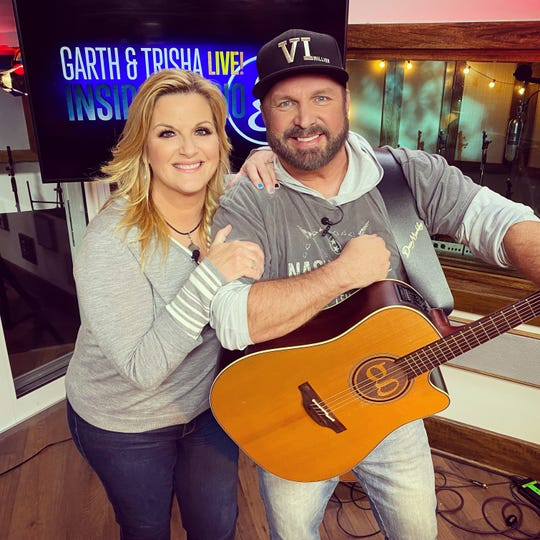 "Garth Brooks and Trisha Yearwood photographed April 1, 2020, inside ""Studio G"" in Nashville, Tennessee."
