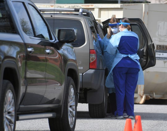 Williamson County Health Department nurses conduct COVID-19 assessments and testing at a drive-thru site at the West Main location in Franklin on April 2, 2020.