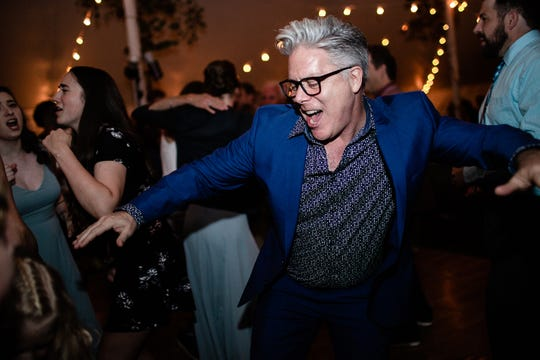The Rev. Mark Lord, the senior minister at Unity Naples, dances at his niece's wedding in September of 2019.