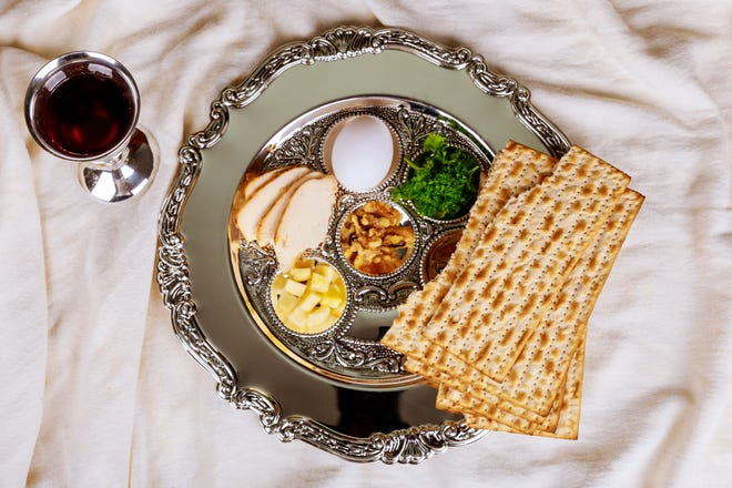 Pesah celebration concept Jewish Passover holiday. Traditional pesah plate text in Hebrew: Passover, egg.