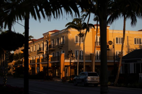 The sunsets over 5th Avenue South in Naples on Monday, March 30, 2020.