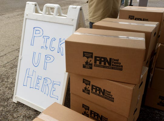 Boxes of food from the Food Pantry Network Serving Licking County at a drive up pantry set up at the South Street Depot in Granville for Denison food preparers and some Granville restaurant employees facing layoffs or reduced hours amid the stay-at-home order in Ohio.