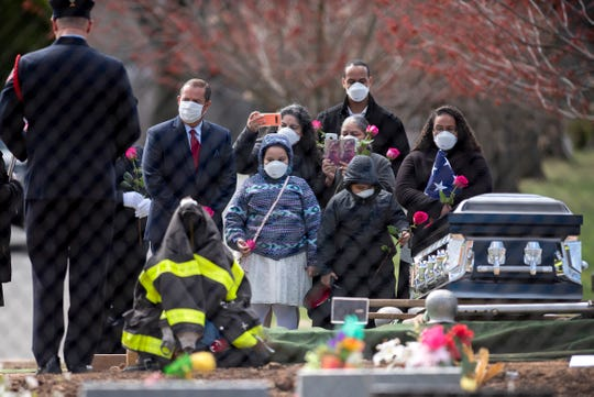 Passaic Firefighter Israel Tolentino, 33, who died from complications of COVID-19, was buried at East Ridgelawn Cemetery on Thursday, April 2, 2020, surrounded by an intimate group due to restrictions on funeral sizes resulting from the coronavirus pandemic.