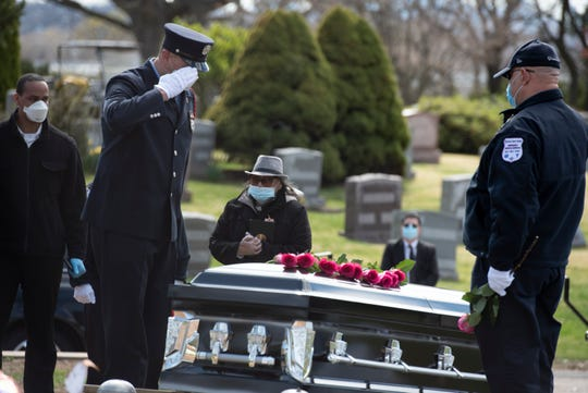 Passaic Firefighter Israel Tolentino, 33, who died from complications of COVID-19, was buried at East Ridgelawn Cemetery on Thursday, April 2, 2020. Fellow Passaic Firefighter Rubio Alfaro salutes the casket of his best friend.