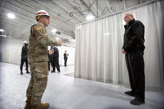 New Jersey Gov. Phil Murphy, right,  tours the new Field Medical Station at the Meadowlands Exposition Center in Seacaucus, N.J.