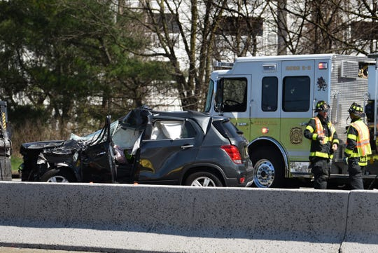 Firefighters are seen next to a crashed vehicle on Route 23 north in Wayne on 04/02/20.