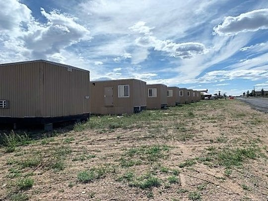 10 trailers to house construction workers for the border wall under construction on Jesus Carreon Avenue in Columbus, New Mexico. Wednesday, April 1, 2020.