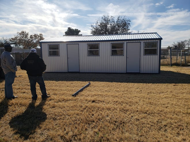 Eddy County Leadership volunteers built a shelter for pets at the Battered Family Shelter in Carlsbad, New Mexico in hopes that those women and families wishing to leave abusive situations could do so without fearing for their pets.