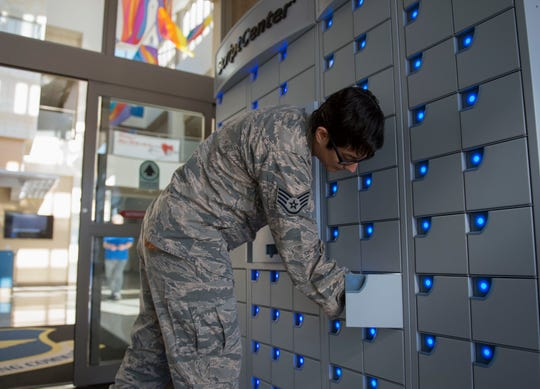 Staff Sgt. Annisia Martin, 49th Medical Group patient, picks up her prescription from the ScriptCenter, March 5, 2020, on Holloman Air Force Base, N.M. The newly open ScriptCenter allows for patients to refill their prescriptions without waiting in line at the pharmacy.