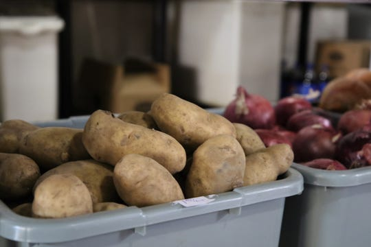 Potatoes and onions are among the produce products sold at Rubia's.