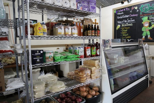 Shelves of food and supplies are seen, Wednesday, April 1, 2020, inside Rubia's in Aztec.