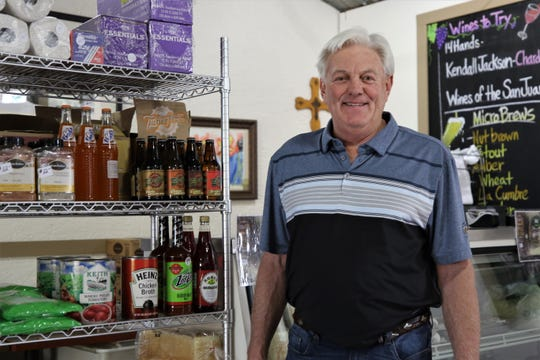 Randy Hodge stands in front of the Rubia's Market on April 1, 2020, in Aztec.