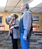Ruidoso Municipal Judge Beverly A. Rankin repeats her oath as her husband, Jack, holds the Bible.