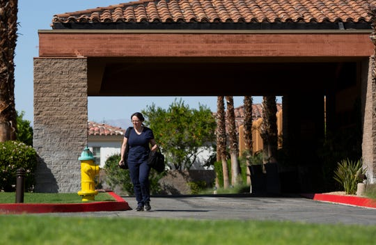 A woman leaves the Rancho Mirage Health and Rehabilitation Center in Rancho Mirage, Calif., on Wednesday, April 1, 2020. Riverside County plans to transfer non-coronavirus patients to nursing homes to open up hospital beds in preparation for the surge.