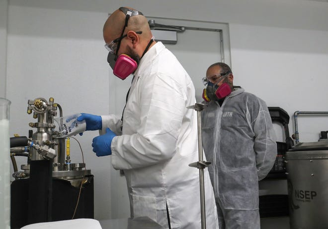Edward Reyes, left, and Steven Sharble of From The Earth manufacture hand sanitizer at the THC extraction facility to be given to local hospitals and first responders in Desert Hot Springs, April 2, 2020.