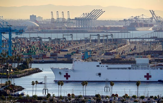 The U.S. Navy Ship Mercy enters the Port of Los Angeles on March 27, 2020.