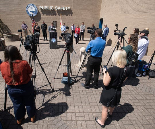 Escambia County officials on April 2 discuss the governor's stay-at-home order during a press conference outside the county's Public Safety Building on W Street.