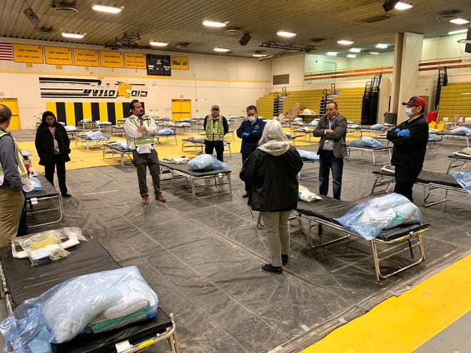 Navajo Nation President Jonathan Nez and Vice President Myron Lizer with health care officials and emergency responders at the federal medical station in Chinle, Arizona.