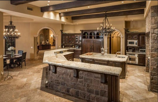 Michael J. Gandy, a manager of 8508 E. Sweetwater Avenue LLC, sold this $2.85M Scottsdale estate that features arched doorways and stone accents.