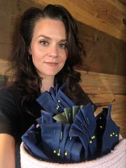 Hilarie Burton with protective masks she has sewn at home.