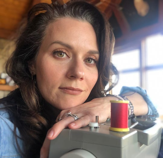 Hilarie Burton at home with her sewing machine, which she is using to make protective masks.
