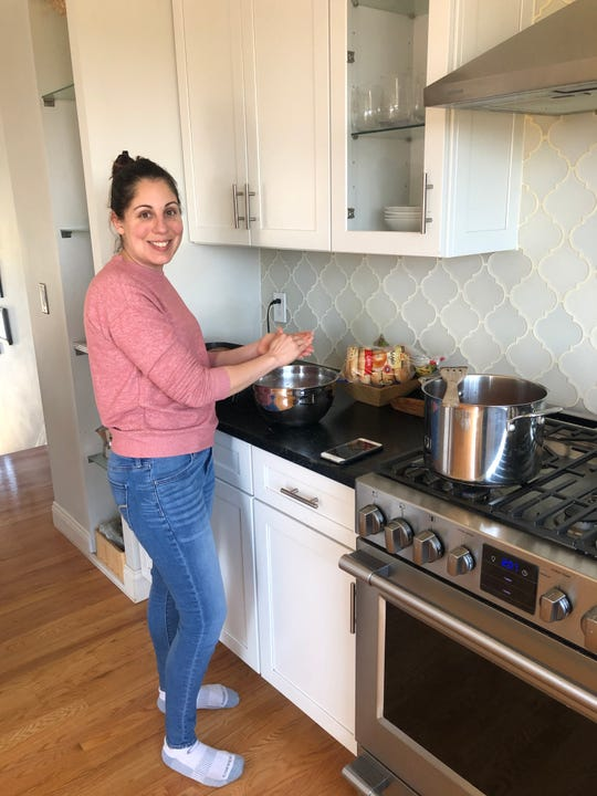 Filomena Fanelli, pictured above in her Poughkeepsie kitchen, started preparing for Easter a few weeks ago, but now plans to deliver dishes to her relatives instead of gathering around the table as they usually do.