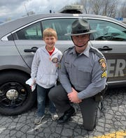 Beckett Loucks, 8, had the opportunity to get a photo with Corporal Benjamin Frantz of the Pennsylvania State Police, Chambersburg barracks, when he and his mom, Brittany West, dropped off free lunches on Wednesday.