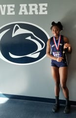 West York's Tesia Thomas is shown after winning a state indoor championship in the triple jump.