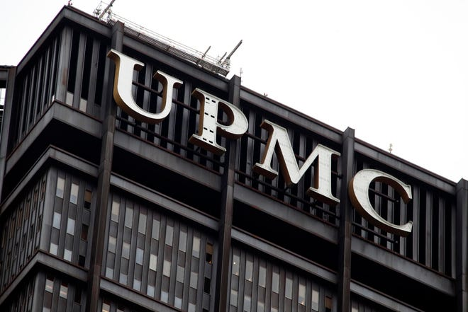 This is the UPMC logo on the UPMC Building in downtown Pittsburgh,Monday, Oct. 29, 2018. (AP Photo/Gene J. Puskar)