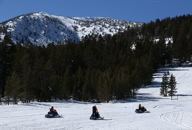 The Washoe County Sheriff's Search & Rescue team respond to a snowmobile rescue at Tahoe Meadows near Reno on April 2, 2020.
