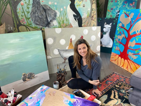 Reno artist Emily Reid is pictured at her home among her paintings of animals while self-isolating on Tuesday, March 31.