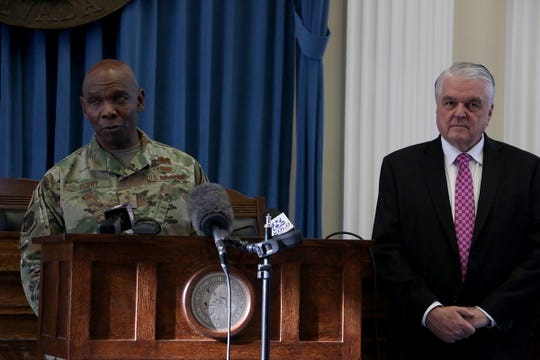 Nevada National Guard Major General Ondra L. Berry speaks alongside Nevada Governor Steve Sisolak during a press conference about the COVID-19 pandemic in the Old Assembly Chambers in the Nevada State Capital Building in Carson City on April 1, 2020.