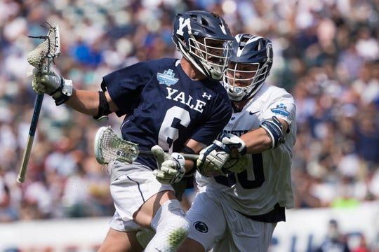 Yale's TD Ierlan (6) controls the ball against Penn State Nittany Lions midfielder Jake Glatz (30) during the first half in the semifinals of the men's NCAA lacrosse national championship at Lincoln Financial Field on May 25, 2019.