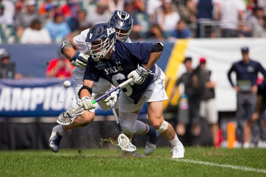 Victor's TD Ierlan of Yale wins a face-off against Gerard Arceri of Penn State during the 2019 NCAA semifinals in Philadelphia.