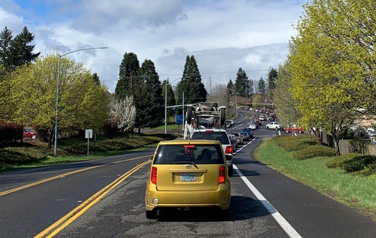 Traffic backed up to pick up rental laptops at Sprague High School on Thursday, April 2.