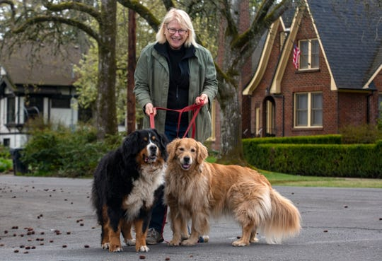 Court-Chemeketa resident Juliana Inman takes her dogs, Jackie and Winnie, for a morning walk in Salem on Thursday, April 2, 2020.