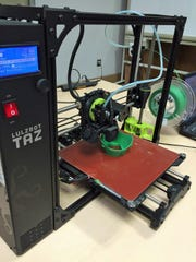 A Monterey County Free Libraries 3D printer creates a face mask, one of many that will be given to first responders and health care workers.