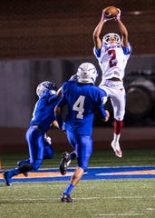 Abilene Cooper High School's Aaron Anderson leaps into the air and brings down the ball for a touchdown catch during the Cougars' 35-31 win over Lake View in a 2014 game at San Angelo Stadium.
