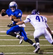Lake View High School's Nick Martinez runs out of the backfield during the Chiefs' first-round playoff game against Canyon on Nov. 14, 2014, in Big Spring.