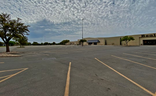 The parking lot of the Sunset Mall is nearly empty as seen in this Thursday, April 2, 2020 photo after the city of San Angelo declared the facility should be closed until further notice.