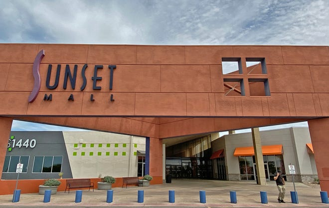 A person walks away from an entrance to the Sunset Mall on Thursday, April 2, 2020 after the building was ordered shut down by the city of San Angelo.