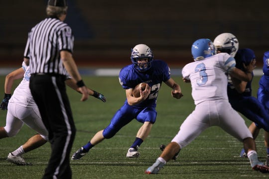 Lake View High School's Eli Peterson looks for daylight in a 2013 game against Lubbock Monterey.