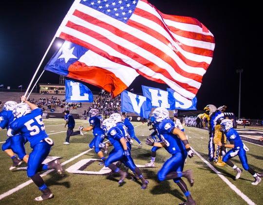 The Lake View Chiefs run onto the field before a game in Big Spring in 2013.