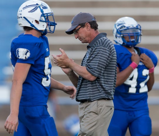 Lake View head football coach Doug Kuhlmann claps before the Chiefs play Lubbock High in a 2013 game at San Angelo Stadium.