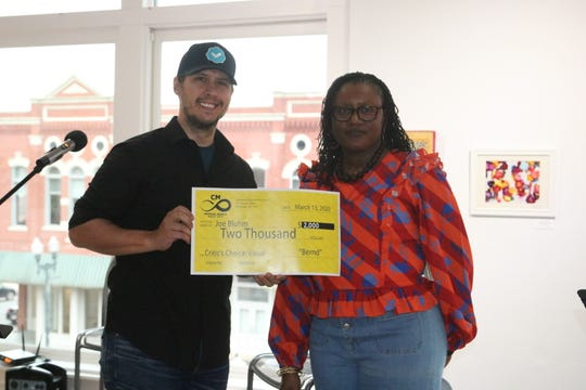"Joe Bluhm accepts $2,000 check for his painting, ""Berndt,"" presented by critic Shantay Robinson at Critical Mass 8 at Artspace."