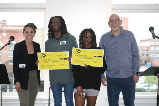 Rachard Dennis and Moni (middle) accept the $2,000 prize for their performance in Critical Mass 8, presented by critics Lauren Smart (left) and Manny Mendoza (right) at Artspace.