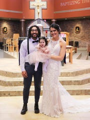 Kelli (Moeller) and Tristen Jackson pose with their 11-month-old daughter Saturday, March 20 at Holy Spirit Community Church. The couple livestreamed their wedding to family and friends who did not attend because of a 10-person gathering limit.