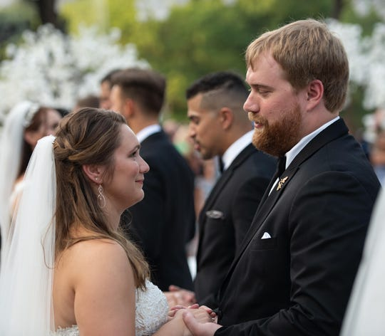 """Heidi Kronaizl and Austin Bushong participated in """"Say Yes to the Dress: America"""" in 2019, where they said their vows with 51 other couples across the county in New York City's Central Park."""